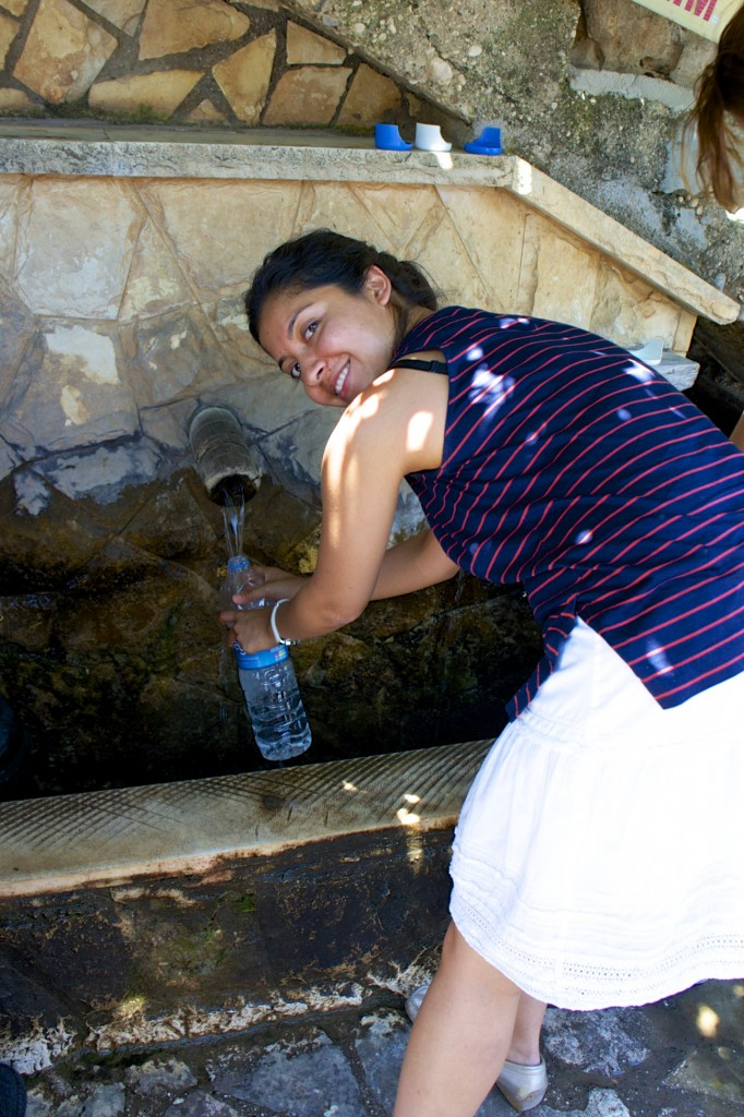 Collecting fresh mountain spring water