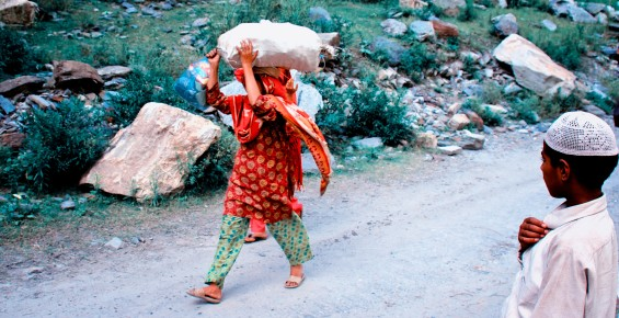 Woman carrying load in Kashmir